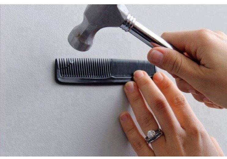 Use a comb to keep the nail in place and save your fingers from being squished