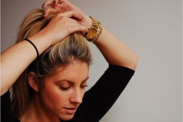 Gather hair at the very top of your head and start to make a ponytail.