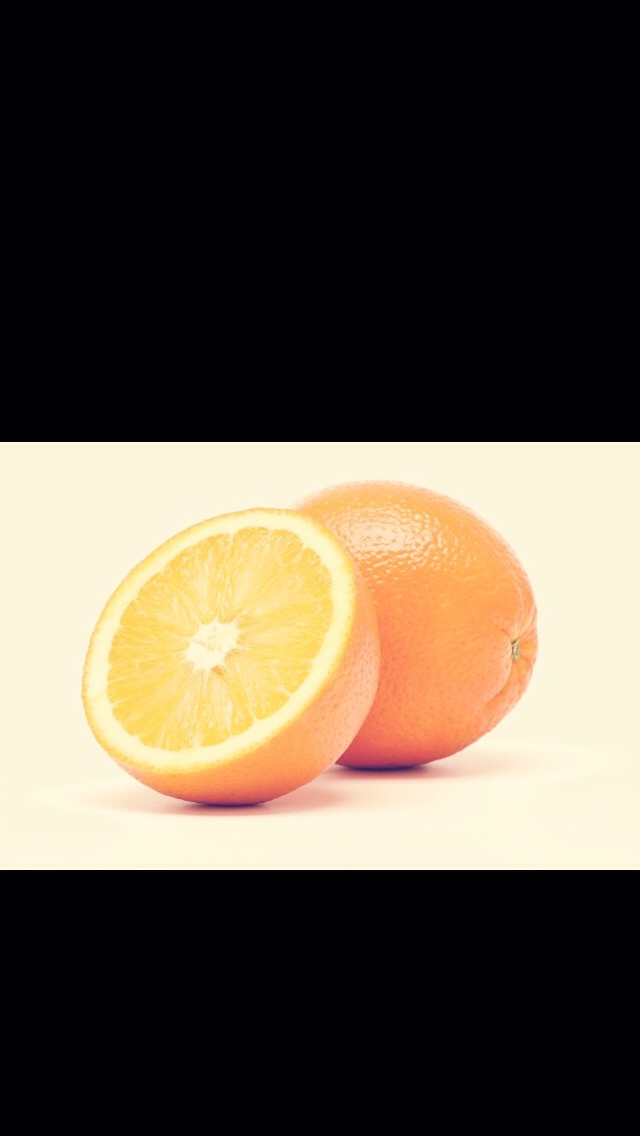 Next take some oranges and cut them in half!