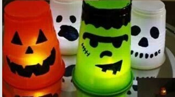 All you need is plastic cups of your color choice and a black marker draw a face on and then put an led candle underneath the cup ! Super cute :) and if you cant find the cups that color you could always paint them or spray paint!