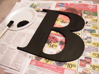 Paint your letter black, it helps make little holes between your pictures unnoticeable (especially if they are black and white) and it helps them blend together better.