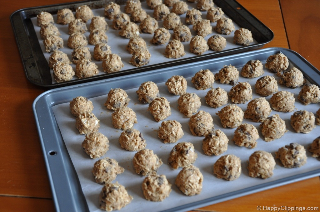 """Form dough into 1 1/4"""" balls and place onto parchment-lined or ungreased baking sheets."""