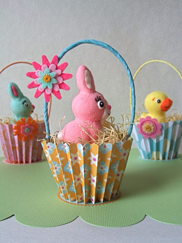 Cupcake holders- fill with straw few chocolates and a topper a little chick or rabbit from the pound store.