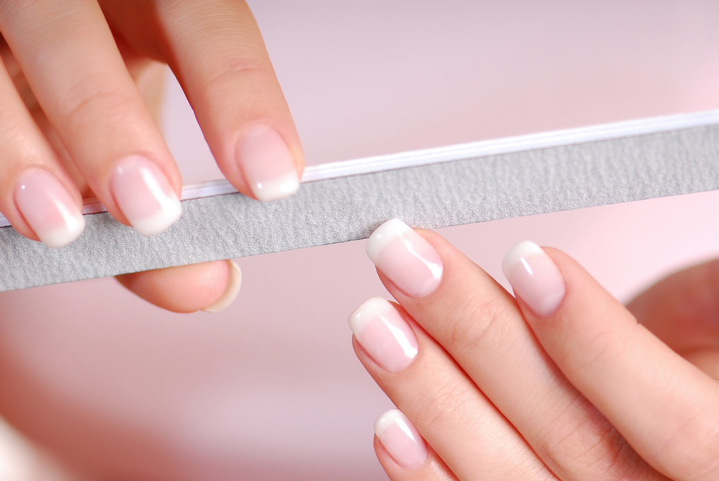 Allow the glue to dry, then gently file the top of the paper so that it is smooth and flush with the nail. Finish with a layer of base coat, two coats of nail polish, and a topcoat.