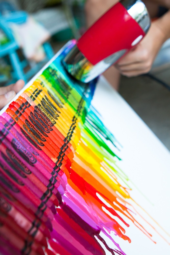 You can melt crayons with a hair dryer and create this amazingly unique, abstract piece of art! Melted crayon wall art! Beautiful!