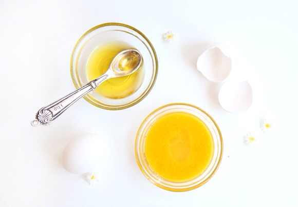 Raw Egg & Olive Oil Treatment Whisk one raw egg and mix in  spoonful of olive oil. Egg yolk is rich in fats and proteins, and is naturally moisturizing. Egg whites removes unwanted oils. Meanwhile, the olive oil acts as en emollient that locks the moisture into hair. Apply leave n 30min before wash