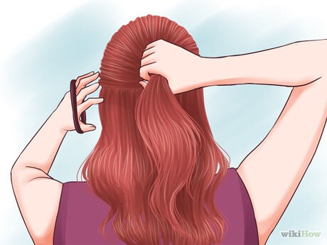 Gather the top layer. Pull the top layer back and away from your face as if you were making a ponytail. Secure it with a hair tie.