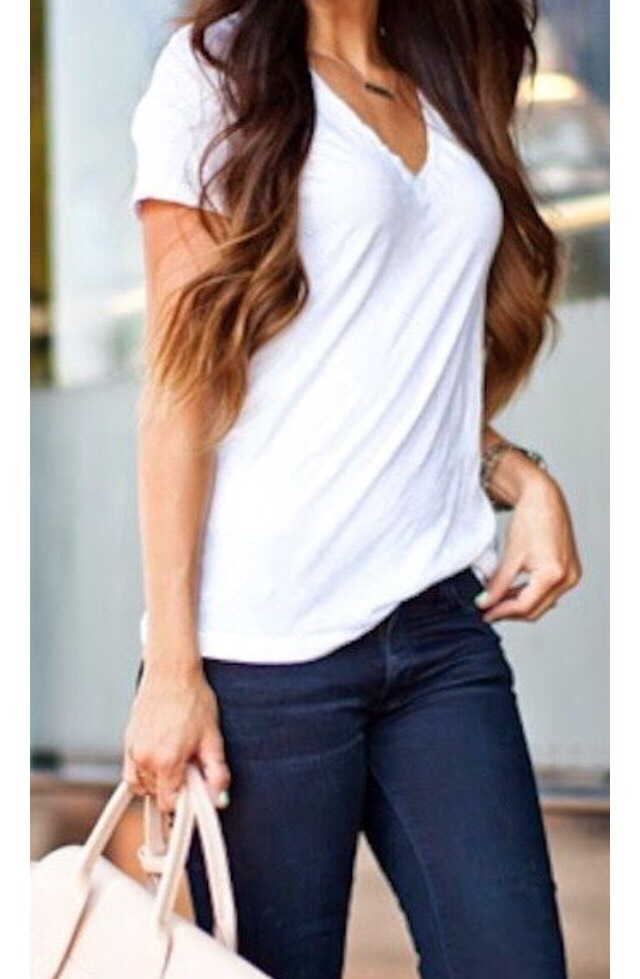 #2 White T-shirt  A basic white t-shirt is a must have this spring that you can dress up or down as per the mood and occasion.