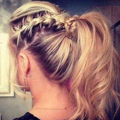 A loose simple French braid in a pony tail