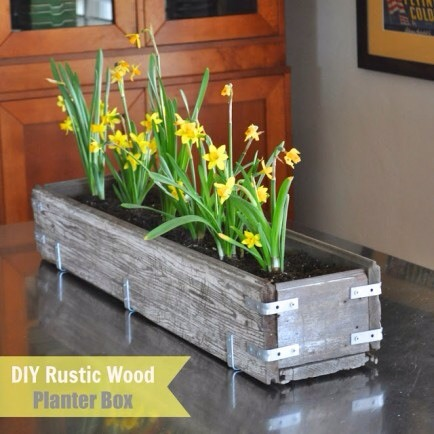 Rustic Wood Planter  This rustic planter is easy to build but has a rough-hewn look that complements both modern and classic styles. Make it yourself out of any wood you can salvage!