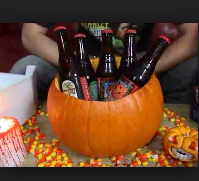 Empty out a pumpkin & add beer & ice or a bowl with goodies!
