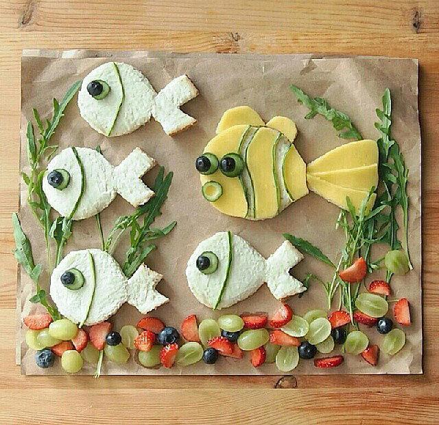 Under the Sea Re-create an oceanic landscape using fruit, veggies, and cream-cheese-covered bread.