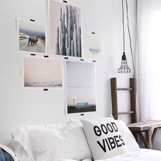 Art can be expensive — if you can't afford a single big piece to hang above your bed, try using washi tape to create an arrangement of smaller prints, as seen onUrban Outfitters.