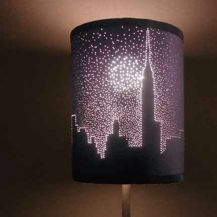 Poke holes in a lamp shade to create the looks of stars or create a look like a landscape like in the picture if you are an artsy person