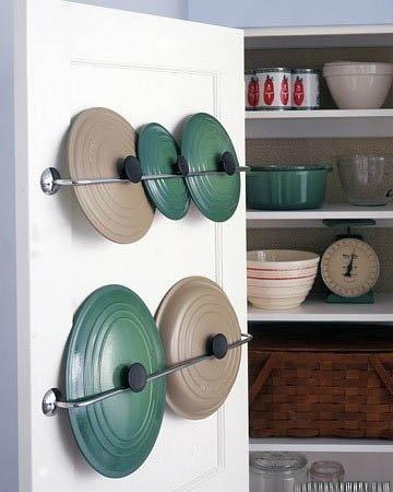 Towel hangers on the inside of a pantry or cupboard door make great storage for awkward saucepan lids!