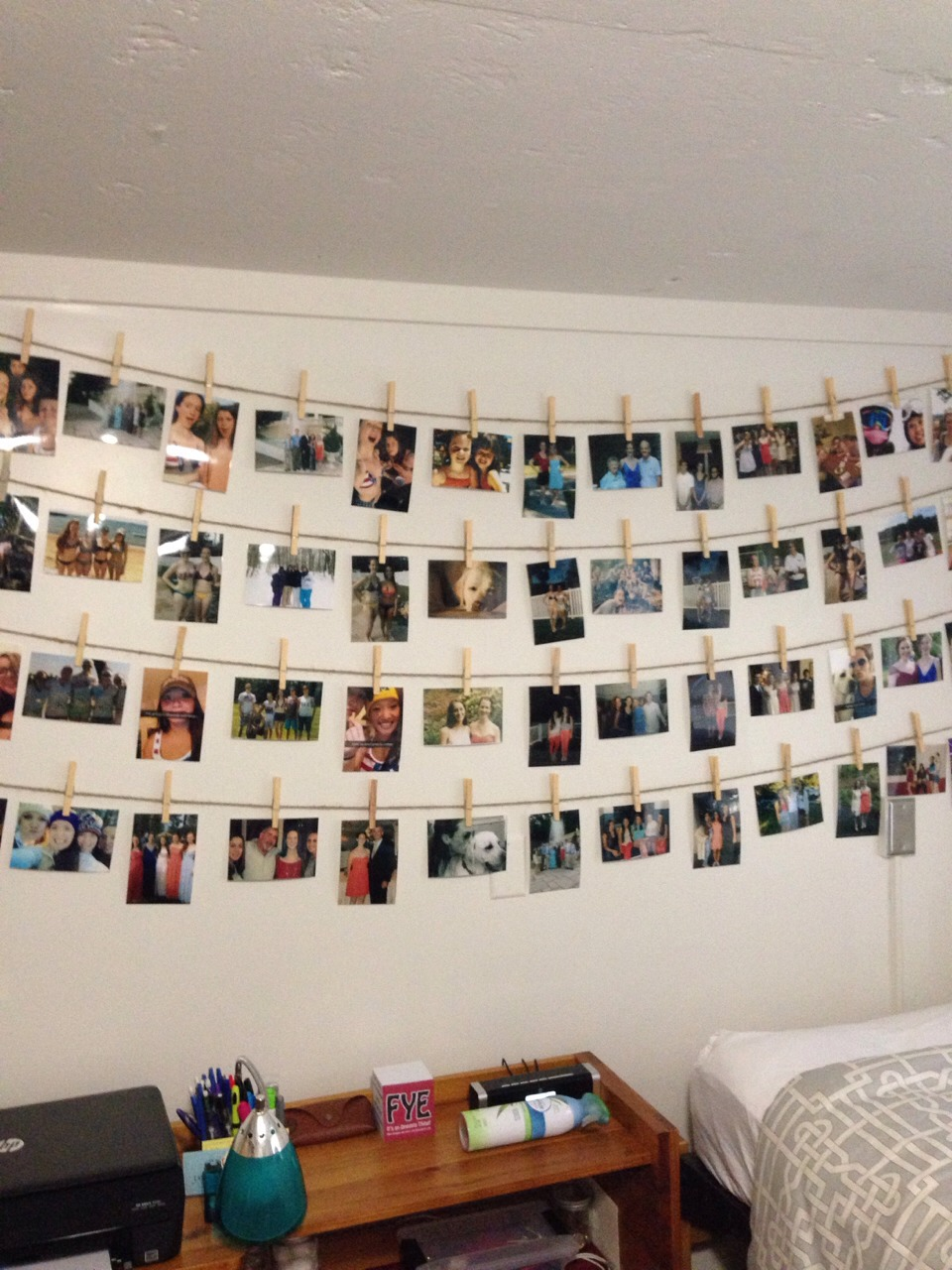 Spice up the room with lots of pictures of family and friends. Twine and clothespins give it more of a modern DIY feel (use clear command hooks to hold up the twine, they are nearly invisible and make it look more elegant).