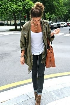 Green or brown coat, White vest top, Black jeans or leggings and a brown leather bag. 💌
