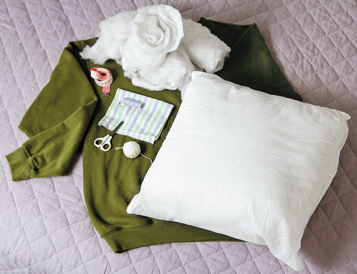 What you need:  Tools: Scissors Thread and some yarn Thick sewnig needle Meter Pins (optional chalk and ruler) Supplies/Ingredients: Used hoodie Acrylic blanket or pieces of cloth Cushion filling or a pillow(45cmx45cm) A flap ( for closing the sleeves)