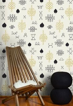 If you have minor imperfections on your wall, use spackle and sandpaper to smooth them away. Don't apply wallpaper primer until your wall looks smooth to the naked eye.