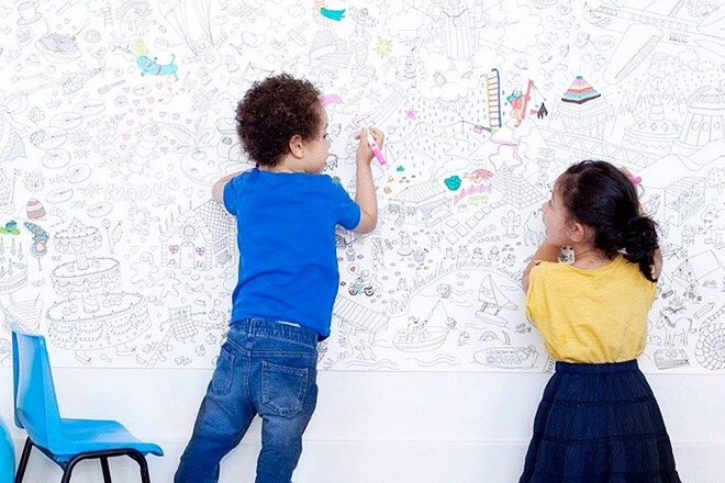 Hang poster or banner paper so you can doodle. You can also write quotes or phrases.