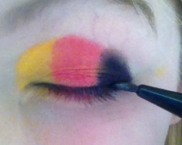 Apply a thin line of eyeliner to define your eyes.