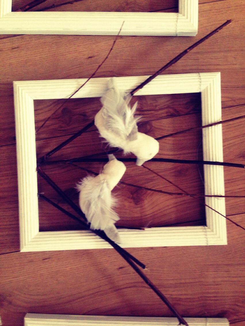 I used hot glue to glue sticks to the inside of the frames then attached the birds where I wanted them.