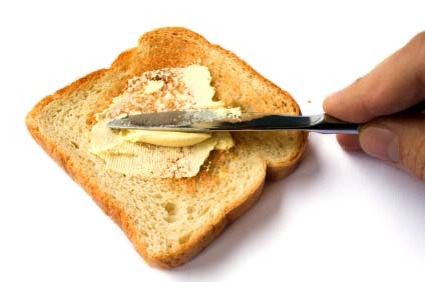 Butter your sliced bread with a small helping of butter or margarine. Let the butter soak into the bread..