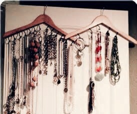 I just took two wooden hangers and screwed hooks (the little ones with the screw end) into the bottom of them this works great for longer pieces and you can hang them right in your closet or leave them out on display!