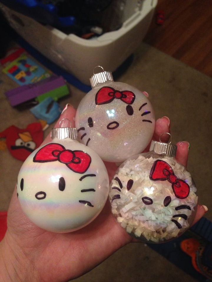 Pretty simple take a sharpie and draw a hello kitty face on an ornament if u need a stencil u can print one online then u can fill it up with anything white like glitter ribbon or pearly paint :)