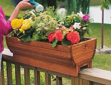 Deck Rail Planter  Spice up your deck rails with these easy and attractive planters -- even designed for drainage!