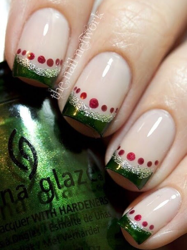 If you love all things Christmasy, consider this nice combo of green and red. Use french manicure stickers to create green tips. Once they've dried, go over it with some silver glitter. Add the red dots later using a dotting tool or toothpick.