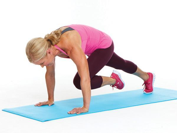 Week 3: Knee Tuck  Targets: Core, chest, and shoulders  Start in plank position, abs tight and shoulders over wrists. Pull left knee toward chest while rounding back slightly, pulling belly button to spine. Slowly press left leg back to start to complete 1 rep. Repeat on right side.