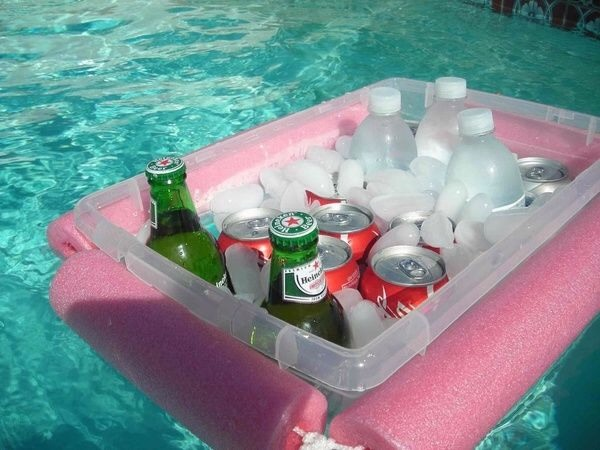 Tie pool noodles together with a rope and a Rubbermaid container. Enjoy ur cold drinks while u enjoy the pool with your family.