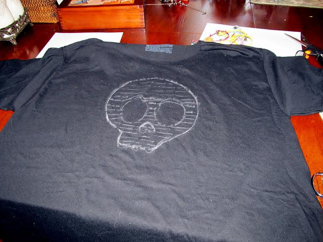 Trace the skull onto  your shirt with chalk ,  using your ruler, make lines about 1/2 of an inch apart.