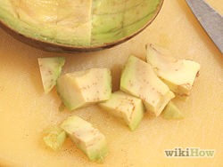 4) Cube the avocado. Cut into the avocado lengthwise at even intervals. Next, cut into the avocado at a 90 degree angle using even intervals to create a crosshatch pattern. Simply scoop the contents of the avocado out using a large spoon.
