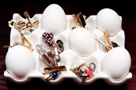 In an Egg Crate  You can use any type of egg crate as a nice way to keep your small pieces of jewelry separated.  Spotted at The Coveteur.  http://thecoveteur.com/George_Kotsiopoulos