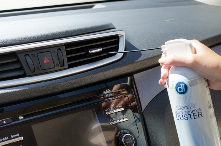 8. Or, blast the dust out of vents and carpeted corners with a can of compressed air. Blowing dust and debris out from vents and the corners of your car's floor will make it easier to vacuum.