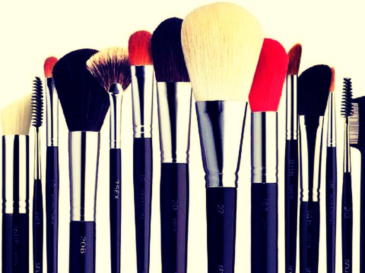 In a cup add hot water and a dab of baby shampoo. Place the brushes in it for 5 to 10 minutes.