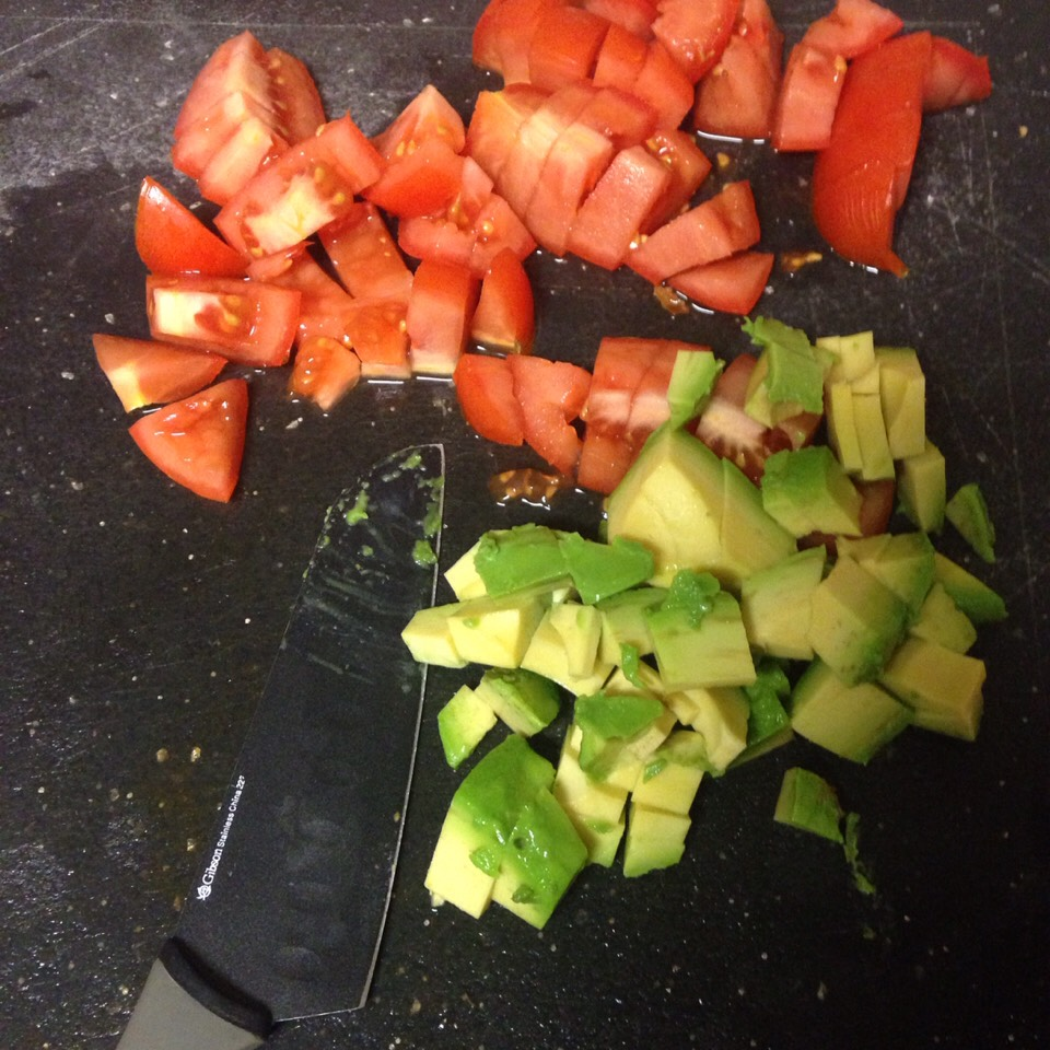 Cut fresh tomatoes and avocado.
