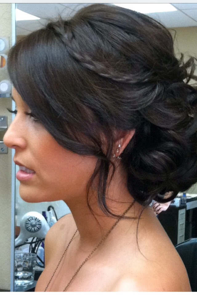 A simple updo with curls pinned to the back with a small braid secured in the curls. This was my prom hairstyle!