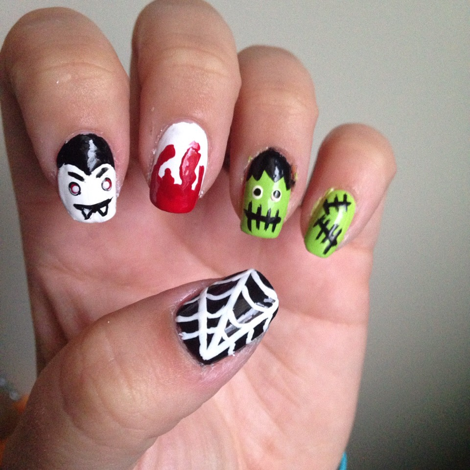 Mix and match haloweeen nails ; frankenstein , Dracula , spider web