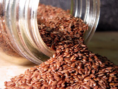 Flax seeds naturally increase breast tissue because of the healthy fats in the seeds. Also, since they're seeds, the body has a harder time digesting them and will help you loose weight in the tummy. There are many ways to eat these, in a shake, in bread, or just by themselves.