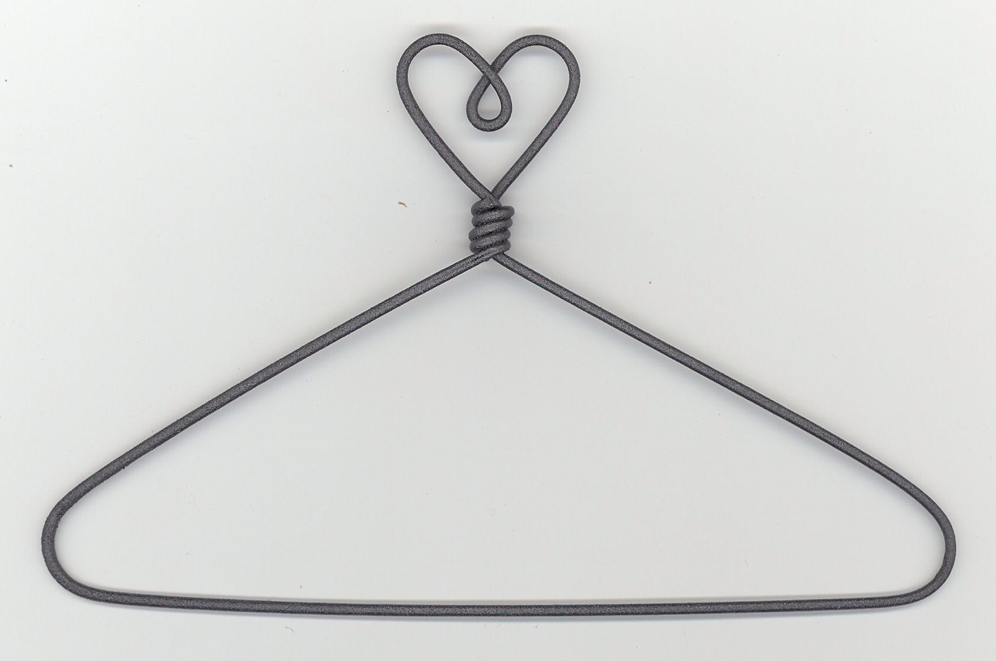 Here's a good use for those wire hangers. They fix static cling! Remove excess static by running a clean wire hanger across the areas where your clothing clings.