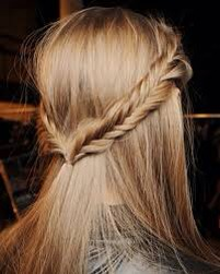 To do this hairstyle, just fishtail braid 2-3 inch sections of hair on both sides tie then together at the back of your head with a clear elastic!
