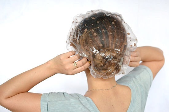 If you've done a full head treatment, you'll want to put a cap on to keep the mixture moist enough to work. It may take some time getting used to. You can do this either during the day, or over night.