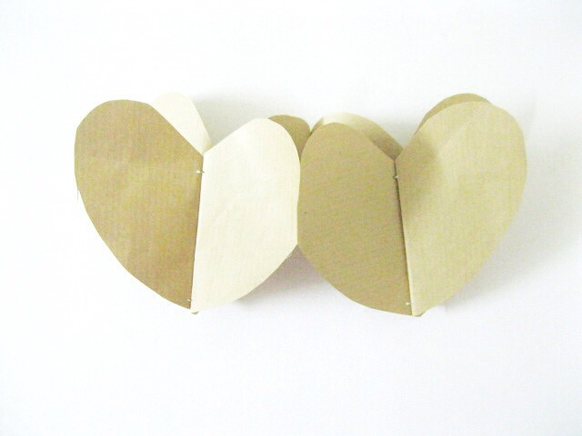 Now take the 2nd heart and apply some glue slightly on the edges of the heart and stick it to the 3rd heart.Repeat the same for the other side of the heart and continue gluing the hearts together.