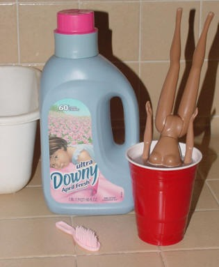 """A small spray bottle with 2 tablespoons of fabric softener and water = """"Doll Hairspray."""""""