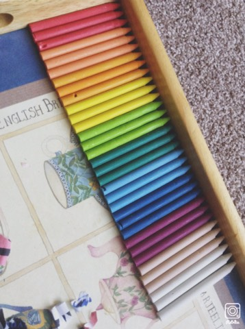 Peel the paper off them so you have a stick of crayon.