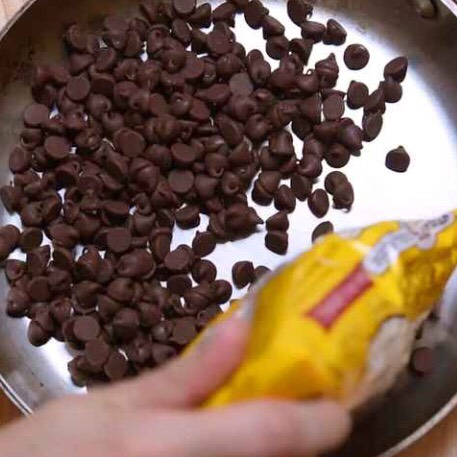 Pour a bag of chocolate chips into an oven safe pan or skillet!
