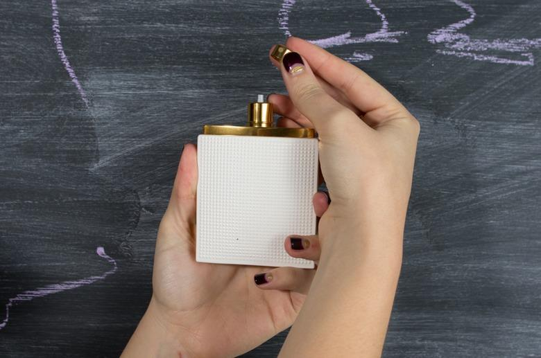 1. Prep Your Fragrance For this story, I picked Elizabeth & James Nirvana White for it's grippy bottle and You can take the metal bit of the spray head off of any perfume bottle by gently tugging.